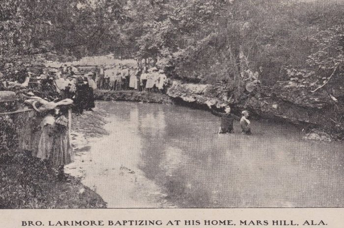Larimore baptizing in Cox Creek